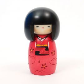 Japanese kokeshi doll with young girl motif in red, AKA OSANAGO